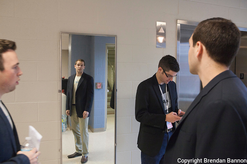 Taylor Mann, left, CEO of CleanSlate and Graeme Clark, reflected in mirror,COO  practice their pitch before getting on the elevator at 43North's business plan competition. Their business won 500,000in financing. The business uses UV light to sanitize devices used in hospitals and nursing homes. 43North business plan competition held in Buffalo, NY awards $5,000,000 dollars annually to start ups. As a condition of the investment award the companies are to  base themselves in Buffalo, NY for one year at an incubator space run by 43North. The final round of the completion was held at Shea's Buffalo Theater in downtown Buffalo, NY. Photo by Brendan Bannon. 10/29/2015