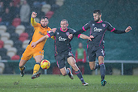 Josh Hanlon of Newport County challenges Dean Winnard and Liam Wakefield of Morecambe during the Sky Bet League 2 match between Newport County and Morecambe at Rodney Parade, Newport, Wales on 10 December 2016. Photo by Mark  Hawkins.