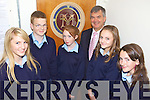 NEW CREST: Students of St Joseph's Secondary School in Ballybunion checking out their new school crest with principal, John O'Donovan, l-r: Jennifer Brosnan, Kevin Keane, Roisin Cummins, Sinead Breen, Claire Walsh.