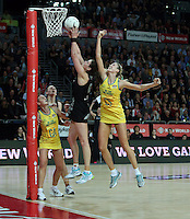 20.09.2012 Silver Leana de Bruin secures the rebound in the last seconds against Australian Caitlin Bassett in action during the second netball test match between the Silver Ferns and the Australian Diamonds played at Vector Arena in Auckland. Mandatory Photo Credit ©Michael Bradley.