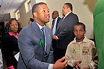 MAY 9, 2011 - MINEOLA, NY: At Nassau County Redistricting hearing, Carrie Solages speaking with (in green sweater) Ramon Smith, with (beige jacket) Ramon Smith, Jr, and others, at Nassau County Executive and Legislative Building at 1550 Franklin Avenue, Mineola, New York, USA on May 9, 2011.