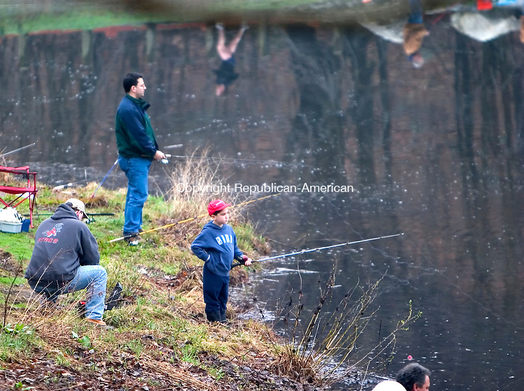MIDDLEBURY, CT - 15 APRIL 2006 -041506JT05--<br /> Stephen Moody, Jr., 8, fishes with his father, Stephen Moody, far left, of Naugatuck, Saturday morning at Hop Brook Lake in Middlebury on the first day of the fishing season.<br /> Josalee Thrift Republican-American
