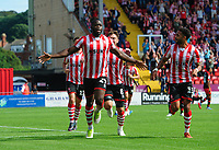 Lincoln City's John Akinde celebrates scoring the opening goal from the penalty spot<br /> <br /> Photographer Chris Vaughan/CameraSport<br /> <br /> The EFL Sky Bet League Two - Lincoln City v Swindon Town - Saturday 11th August 2018 - Sincil Bank - Lincoln<br /> <br /> World Copyright &copy; 2018 CameraSport. All rights reserved. 43 Linden Ave. Countesthorpe. Leicester. England. LE8 5PG - Tel: +44 (0) 116 277 4147 - admin@camerasport.com - www.camerasport.com
