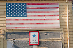Faded painted U.S. Flag and Blue Star for a family's solder in the U.S. Marine Corps