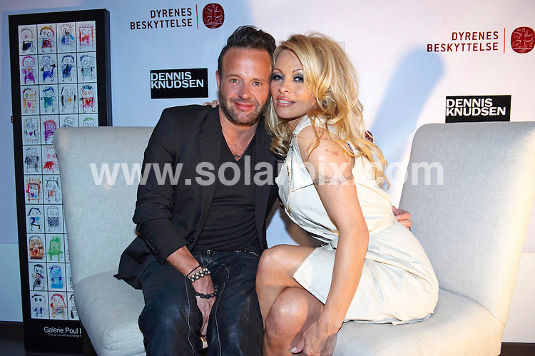 **ALL ROUND PICTURES FROM SOLARPIX.COM**                                             **UK AND SPAIN SYNDICATION RIGHTS ONLY**                                                                                  Pamela Anderson at the Apartment Showroom in Hollywood - she was there to talk about the Danish fur industry which she doesn't approve of, but she also got a chance to try out some animal friendly Danish products by Copenhagen Artificial Fur and cosmetics by Dennis Knudsen                                                                          This pic:      Pamela Anderson and Dennis Knudsen                                                                                       JOB REF:    12911    CPR       DATE:    02.03.11                                                        **MUST CREDIT SOLARPIX.COM OR DOUBLE FEE WILL BE CHARGED**                                                                      **MUST AGREE FEE BEFORE ONLINE USAGE**                               **CALL US ON: +34 952 811 768 or LOW RATE FROM UK 0844 617 7637**