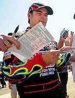 Apr 17, 2009; Avondale, AZ, USA; NASCAR Sprint Cup Series driver Jeff Gordon signs autographs during practice for the Subway Fresh Fit 500 at Phoenix International Raceway. Mandatory Credit: Mark J. Rebilas-