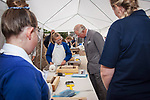 Prince of Wales, Prince Charles visits the Scottish Lime Centre Trust, Charlestown, Fife. Limekilns Primary School children learning to carve masons' marks into tablets of limestone. HRH speaks with pupil Olivia Young. 08 Sep 2017. Charlestown. Credit: Photo by Tina Norris. Copyright photograph by Tina Norris. Not to be archived and reproduced without prior permission and payment. Contact Tina on 07775 593 830 info@tinanorris.co.uk  <br /> www.tinanorris.co.uk