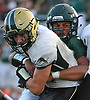 Jake Murphy #21 of Longwood, left, fights for rushing yards as Malik Grant #71 of Lindenhurst wraps him up during a Suffolk County Division I varsity football game at Lindenhurst Middle School on Friday, Sept. 15, 2017.