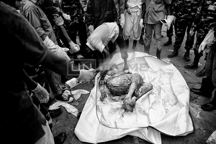 After 15 days of Rana Plaza collapse, rescue worker found a garments worker dead body from the inside of the collapsed building.  Savar, near Dhaka, Bangladesh
