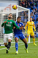 (L-R) Martin Montoya of Brighton challenged by Kadeem Harris of Cardiff City during the Premier League match between Cardiff City and Brighton & Hove Albion at the Cardiff City Stadium, Cardiff, Wales, UK. Saturday 10 November 2018