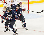Ryan Tyson (UConn - 17), Patrick Kirtland (UConn - 24), Teddy Doherty (BC - 4) - The Boston College Eagles defeated the visiting University of Connecticut Huskies 3-2 on Saturday, January 24, 2015, at Kelley Rink in Conte Forum in Chestnut Hill, Massachusetts.