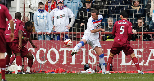 David Weir fails to clear the ball which falls to Laryea Kingston to score for Hearts