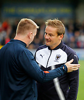 Brentford manager, Dean Smith and AFC Wimbledon manager, Neal Ardley chat pre kick off during the Carabao Cup match between AFC Wimbledon and Brentford at the Cherry Red Records Stadium, Kingston, England on 8 August 2017. Photo by Carlton Myrie.