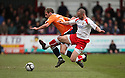 Jake Howells of Luton is tackled by Chris Beardsley of Stevenage during the  Blue Square Premier match between Stevenage Borough and Luton Town at the Lamex Stadium, Broadhall Way, Stevenage on Saturday 3rd April, 2010.© Kevin Coleman 2010 .