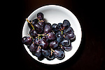 25 January 2010 -- Daily picture for January 25, 2010 Photograph of grapes in a white bowl on a dark table. PHOTO/Daniel Johnson (Copyright 2010 Daniel Johnson)