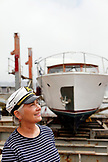 USA, California, Sausalito, a portrait of Victoria Colella in the shipyard, she is a guide for the Wooden Boat Tour