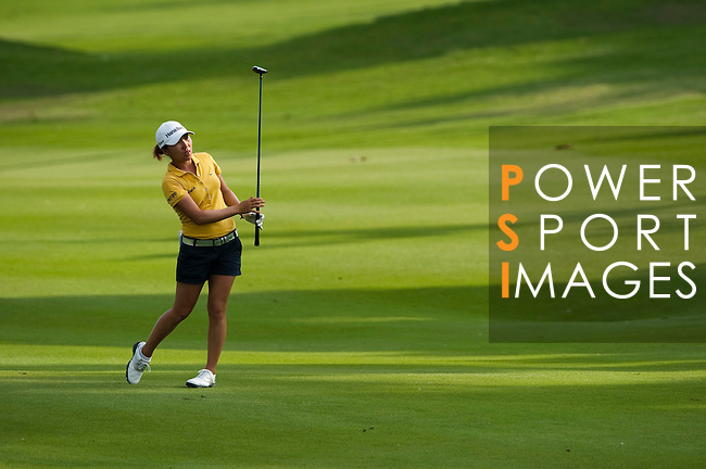 CHON BURI, THAILAND - FEBRUARY 19:  In Kyung Kim of South Korea plays her second shot on the 18th hole during day three of the LPGA Thailand at Siam Country Club on February 19, 2011 in Chon Buri, Thailand. Photo by Victor Fraile / The Power of Sport Images