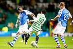 Celtic v St Johnstone...30.10.12      Scottish Communities Cup.Gregory Tade is tackled by Efe Ambrose.Picture by Graeme Hart..Copyright Perthshire Picture Agency.Tel: 01738 623350  Mobile: 07990 594431