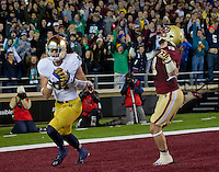 Wide receiver John Goodman (81) makes a third quarter TD catch in front of Boston College Eagles cornerback Sean Sylvia (19).