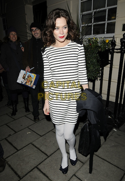 "ANNA FRIEL .leaves after the evening performance of ""Breakfast At Tiffany's"", Theatre Royal, Haymarket, London, England, UK, .8th January 2010 .full length black and white breton striped dress tights shoulder pads buttons bag ballet flats .CAP/CAN.©Can Nguyen/Capital Pictures"