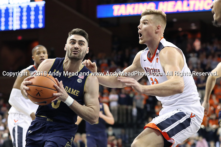 CHARLOTTESVILLE, VA - MARCH 03: Notre Dame's Matt Farrell (5) and Virginia's Jack Salt (NZL) (33). The University of Virginia Cavaliers hosted the University of Notre Dame Fighting Irish on March 3, 2018 at John Paul Jones Arena in Charlottesville, VA in a Division I men's college basketball game. Virginia won the game 62-57.