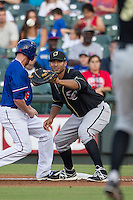Omaha Storm Chasers first baseman Matt Fields (15) waits for a pick off throw during the Pacific Coast League baseball game against the Round Rock Express on June 1, 2014 at the Dell Diamond in Round Rock, Texas. The Express defeated the Storm Chasers 11-4. (Andrew Woolley/Four Seam Images)