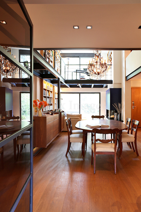 modern contemporary dining room with mezzanine