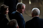 WASHINGTON, DC - DECEMBER 3 : Former president George W. Bush and wife Laura Bush wait for the arrival of former president George H.W. Bush as he lies in State at the U.S. Capitol Rotunda on Capitol Hill on Monday, Dec. 03, 2018 in Washington, DC. (Photo by Jabin Botsford/Pool)