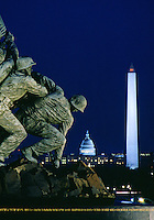 Marine Corps Memorial (Iwo Jima) with the Capitol and Washington Monument at night.