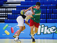 11 JUN 2010 - LONDON, GBR - Bulgaria's Borislav Kobakov tries to force his way through the Cypriot defence during the teams match  at their 2012 European Handball Championships Qualification Tournament (PHOTO (C) NIGEL FARROW)