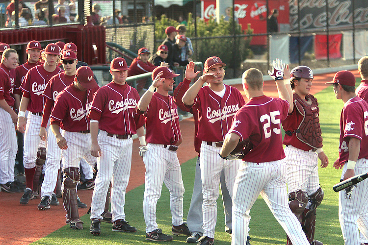 The Washington State bench celebrates with Derek Jones after hitting a home run that helped the Cougars defeat Stanford in a Pac-10 conference tilt at Bailey-Brayton Field in Pullman, Washington, on May 1, 2009.