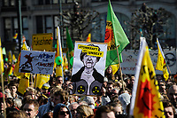 GERMANY Hamburg 2011 march 26 , large rally and meeting at townhall market against nuclear power after accident Fukushima in Japan, poster with counterfeit Angela Merkel and slogan: nuclear power is unsexy