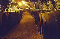 """The Royal Tokaji Wine company in Mad: the wine cellar with long tunnels filled with wooden barrels with ageing Tokaj wine. The RTWC in was one of the first Tokaj wineries to be """"revived"""" by an injection of foreign capital. It makes wine in a traditional style. Credit Per Karlsson BKWine.com"""