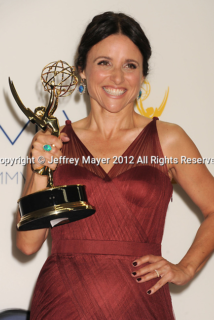 LOS ANGELES, CA - SEPTEMBER 23: Julia Louis-Dreyfus poses in the press room at the 64th Primetime Emmy Awards held at Nokia Theatre L.A. Live on September 23, 2012 in Los Angeles, California.