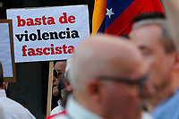 "Demonstrators  supports President Maduro holds a poster entitle ""Stop Fascism violence""."