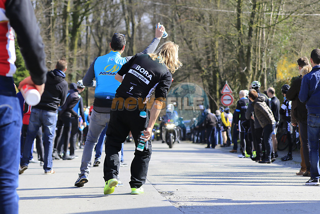 Team helpers wait on the climb of La Houpe for the riders during the 60th edition of the Record Bank E3 Harelbeke 2017, Flanders, Belgium. 24th March 2017.<br /> Picture: Eoin Clarke   Cyclefile<br /> <br /> <br /> All photos usage must carry mandatory copyright credit (&copy; Cyclefile   Eoin Clarke)