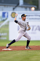 Staten Island Yankees shortstop Vicente Conde (12) turns a double play during a game against the Batavia Muckdogs on August 6, 2014 at Dwyer Stadium in Batavia, New York.  Batavia defeated Staten Island 5-3.  (Mike Janes/Four Seam Images)