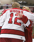 Colin Moore (Harvard - 12), Lisa Moore - The Harvard University Crimson defeated the visiting Clarkson University Golden Knights 3-2 on Harvard's senior night on Saturday, February 25, 2012, at Bright Hockey Center in Cambridge, Massachusetts.
