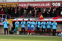 Dagenham coaches and substitutes with a minute of applause in memory of Jodie Chesney during Dagenham & Redbridge vs Bromley, Vanarama National League Football at the Chigwell Construction Stadium on 9th March 2019