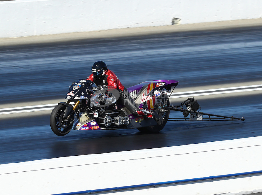 Feb 12, 2017; Pomona, CA, USA; NHRA top fuel nitro Harley rider Tii Tharpe during the Winternationals at Auto Club Raceway at Pomona. Mandatory Credit: Mark J. Rebilas-USA TODAY Sports
