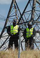 Climate Camp. 9/8/08 Enviromental protesters converge on Kingsnorth in Kent to protest over plans to build a new coal fired power station on the site. Activists head across country to the Power Station. Some scaled the fence others scuffled with the Police. Riot Police guarding the power station.