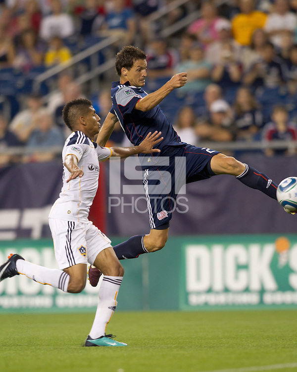 New England Revolution midfielder Marko Perovic (29) gets high in attempt to control a long pass as Los Angeles Galaxy defender Sean Franklin (28) defends. The New England Revolution defeated LA Galaxy, 2-0, at Gillette Stadium on July 10, 2010.