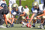 Beverly Hills, CA 09/23/11 - Ryan Gilani (Peninsula #75) and unidentified Peninsula player(s) in action during the Peninsula-Beverly Hills frosh football game at Beverly Hills High School.