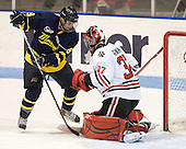 Carter Madsen (Merrimack - 9), Chris Rawlings (Northeastern - 37) - The visiting Merrimack College Warriors defeated the Northeastern University Huskies 4-3 (OT) on Friday, February 4, 2011, at Matthews Arena in Boston, Massachusetts.