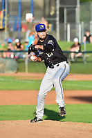 Missoula Osprey starting pitcher Dallas Newton (29) delivers a pitch to the plate against the Ogden Raptors in Pioneer League action at Lindquist Field on August 4, 2014 in Ogden, Utah.  (Stephen Smith/Four Seam Images)
