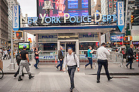 NYPD substation in Times Square in New York seen on Thursday, March 10, 2016. With the renovation in store for the substation the city is pondering where and how to preserve the mosaics on the eastern and western walls. Prior to its life as a substation the small building was the Times Square Information Center opened in 1957 with the police taking residency in 1993. (© Richard B. Levine)