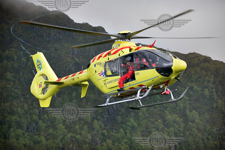 Crew from Norwegian Air Ambulance fly a training mission in the Bergen area. Doctor B&aring;rd Einar Heradstveit at the door. Pilot Marius Malmo.<br />