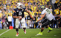 Jan 10, 2011; Glendale, AZ, USA; Auburn Tigers quarterback Cameron Newton (2) is pressured by Oregon Ducks defensive tackle Brandon Bair (88) during the fourth quarter of the 2011 BCS National Championship game at University of Phoenix Stadium.  Mandatory Credit: Mark J. Rebilas-