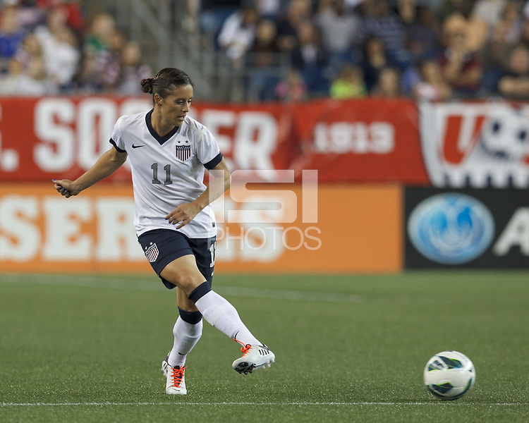 USWNT substitute defender Ali Krieger (11) short pass. In an international friendly, the U.S. Women's National Team (USWNT) (white/blue) defeated Korea Republic (South Korea) (red/blue), 4-1, at Gillette Stadium on June 15, 2013.