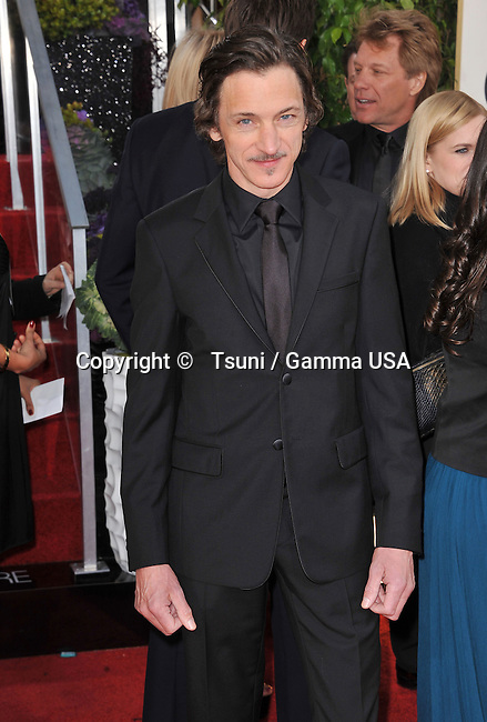 John Hawkes at the 70th Golden Globes Awards 2013 at the  Hilton Hotel In Beverly Hills.
